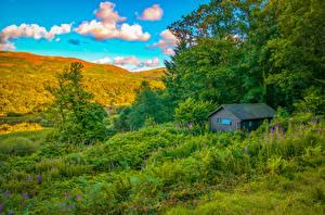 Фото Здания Холмы Трава Деревья Облака Природа
