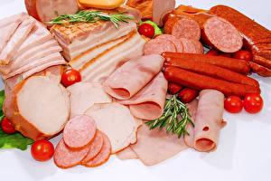 Фотография Мясные продукты Колбаса Ветчина Помидоры Продукты питания