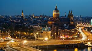 Фото Нидерланды Амстердам Дома Дороги Ночь Уличные фонари Города