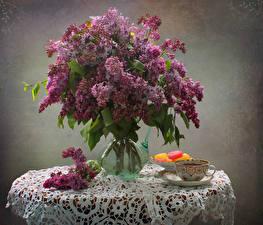 Картинки Натюрморт Сирень Мармелад Букеты Ваза Чашка Цветы