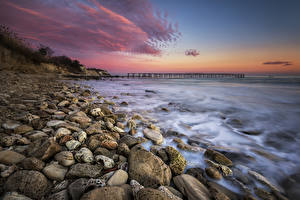 Фото Рассветы и закаты Побережье Камни Волны Природа