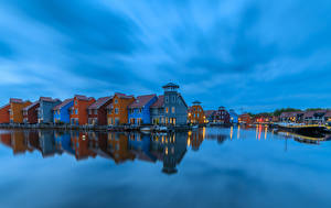 Фото Нидерланды Здания Речка Вечер Пирсы Groningen
