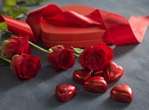Картинки Конфеты День всех влюблённых Красный Ленточка Цветы