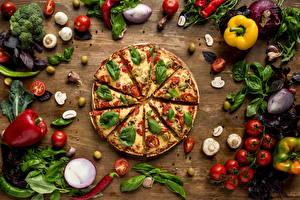Фотографии Фастфуд Пицца Овощи Перец овощной Грибы Помидоры Лук репчатый Базилик душистый Еда