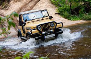 Фотография Jeep Вода Внедорожник Желтый Автомобили
