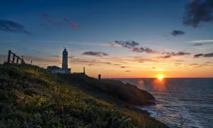 Фотография Испания Берег Рассветы и закаты Маяки Трава Santander Cantabria