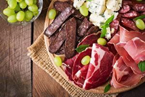 Фотография Ветчина Колбаса Мясные продукты Нарезанные продукты