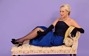 Картинки Lucy Anne Brooks Цветной фон Блондинка Улыбка Кресло Сидит Платье Перчатки Девушки