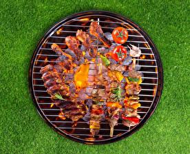 Фотографии Мясные продукты Шашлык Курица запеченная Томаты Еда