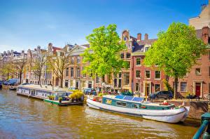 Картинка Нидерланды Амстердам Здания Причалы Речные суда Водный канал Города