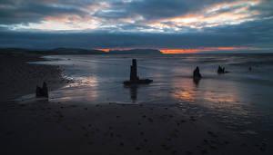 Картинки Рассветы и закаты Берег Море Природа