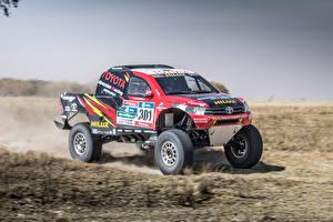Фотографии Toyota Стайлинг Гонки Пикап кузов 2017 Hilux Evo Rally Dakar машины