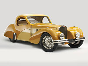 Фото BUGATTI Винтаж Серый фон Желтый Металлик 1937 Type 57S Atalante Авто