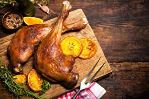 Картинки Курица запеченная Апельсин Разделочная доска Еда