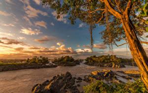 Фото Тропики Рассветы и закаты Реки Камни Небо Деревья Laos Природа