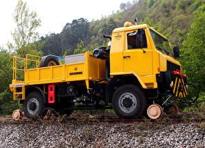 Картинка Грузовики Желтый Uromac T-Rail SV Авто