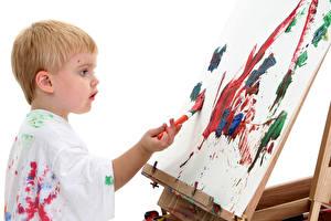 Фото Мальчишка Кисть Лист бумаги Ребёнок Дети