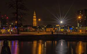 Картинки Нидерланды Здания Речка Ночь Уличные фонари Groningen