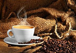Фотографии Кофе Чашка Зерна Пар Продукты питания