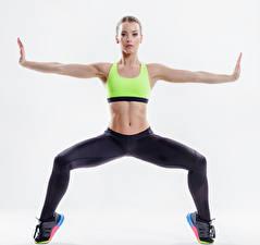 Фото Фитнес Белый фон Физические упражнения Руки Живот Взгляд Девушки Спорт