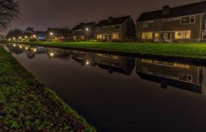 Обои Нидерланды Здания Вечер Водный канал Улица Уличные фонари Groningen