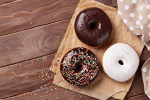 Фотографии Выпечка Пончики Шоколад Доски Три Еда