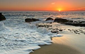 Фотографии Рассвет и закат Берег Волны Камень Море Природа