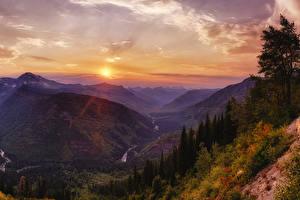 Картинка США Парки Горы Рассвет и закат Небо Пейзаж Каньона Glacier National Park Природа