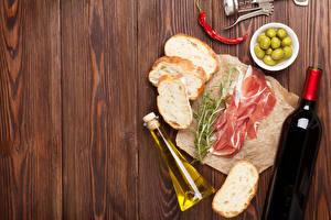 Картинки Вино Хлеб Ветчина Оливки Перец Доски Бутылка Пища