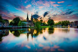 Обои Нидерланды Вечер Дома Реки Delft