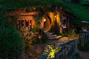 Фото Новая Зеландия Парк Дома Вечер Уличные фонари Hobbit House Matamata Города