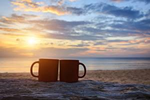 Фотография Рассветы и закаты Небо Море Кружка Вдвоем Пляж Песок Природа