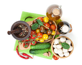 Фотографии Овощи Огурцы Грибы Томаты Приправы Чеснок Белый фон Еда