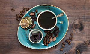Картинки Кофе Шоколад Орехи Лимоны Доски Чашка Зерна Продукты питания