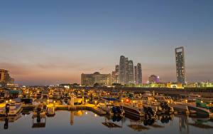 Картинка Объединённые Арабские Эмираты Здания Пирсы Катера Вечер Abu Dhabi Города