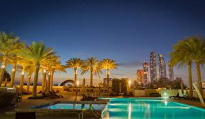 Фотографии ОАЭ Курорты Здания Бассейны Ночь Пальма Abu Dhabi город