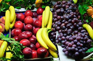 Фотографии Фрукты Виноград Сливы Бананы Пища