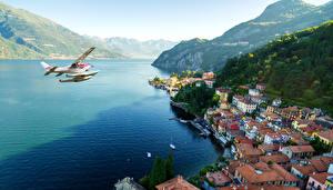Фотография Италия Здания Озеро Горы Берег Гидроплан Varenna Города