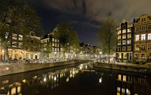 Обои Нидерланды Амстердам Дома Вечер Водный канал Уличные фонари