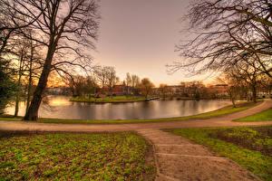 Картинка Нидерланды Здания Речка Вечер Деревья Haarlem
