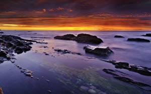 Картинки Пейзаж Море Рассветы и закаты Камень Небо Природа