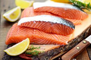 Фото Морепродукты Рыба Лимоны Еда