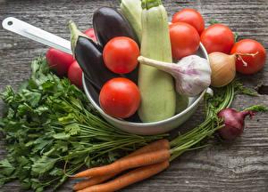 Фото Овощи Томаты Морковь Чеснок Баклажан Лук репчатый Продукты питания