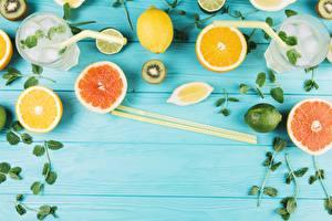 Обои для рабочего стола Цитрусовые Лимоны Грейпфрут Палочки для еды Стакан Доски Еда
