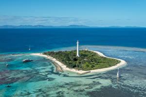 Фотография Франция Море Остров Маяк Причалы Amedee Lighthouse Природа