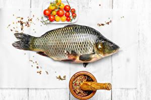 Фото Морепродукты Рыба Специи Томаты Доски Еда