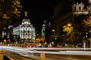 Фотографии Испания Мадрид Здания Дороги Ночь Уличные фонари Города