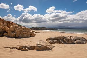 Фотография Берег Море Камень Небо Пляж Песок Облака