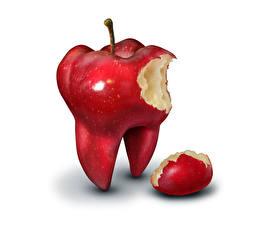 Фотография Креатив Яблоки Белый фон Красный Зубы Продукты питания
