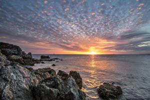 Фотография Франция Море Рассветы и закаты Небо Скала New-Caledonia